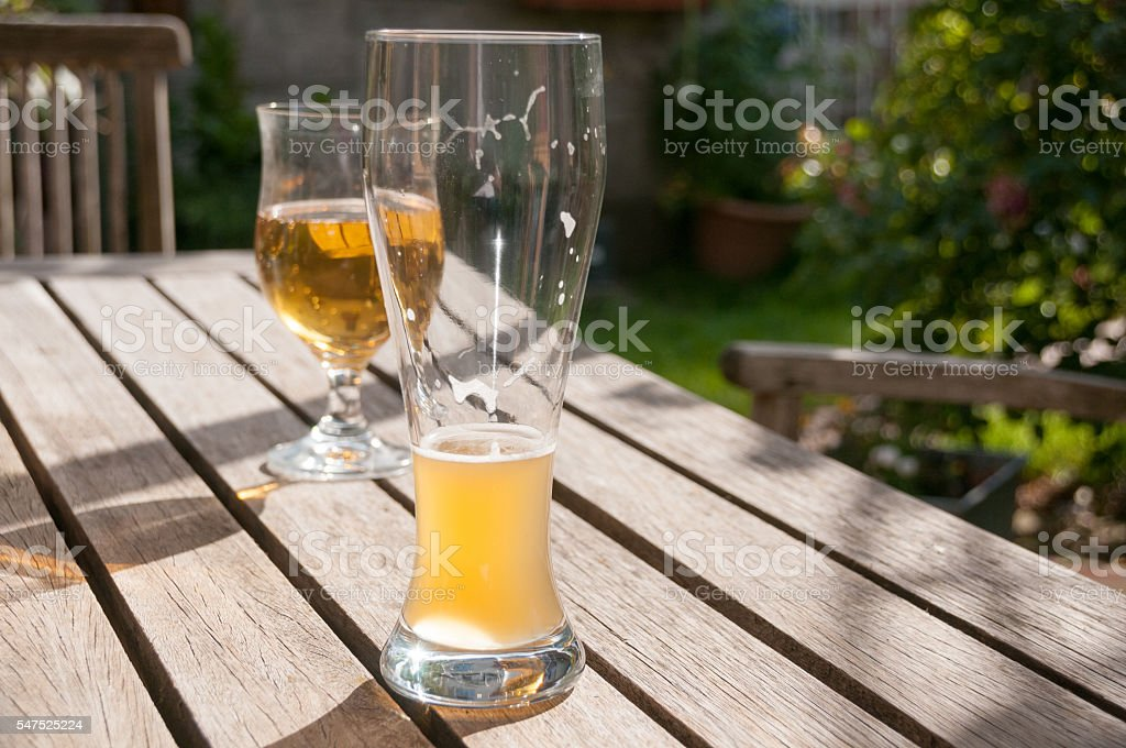 Beer glasses on a table stock photo