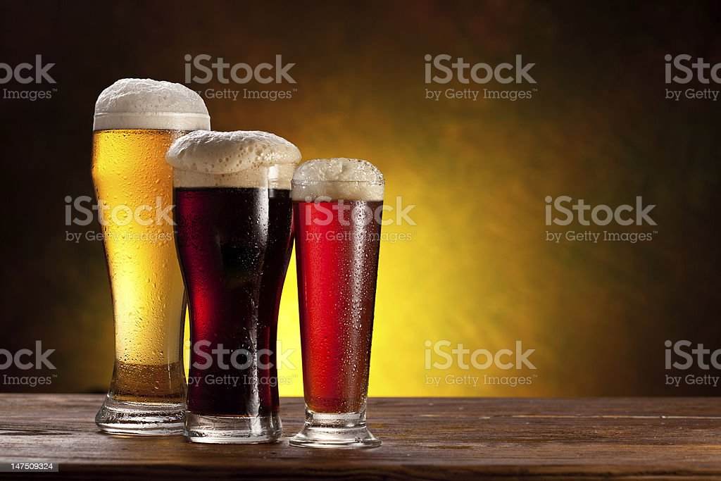 Beer glasses on a wooden table. royalty-free stock photo