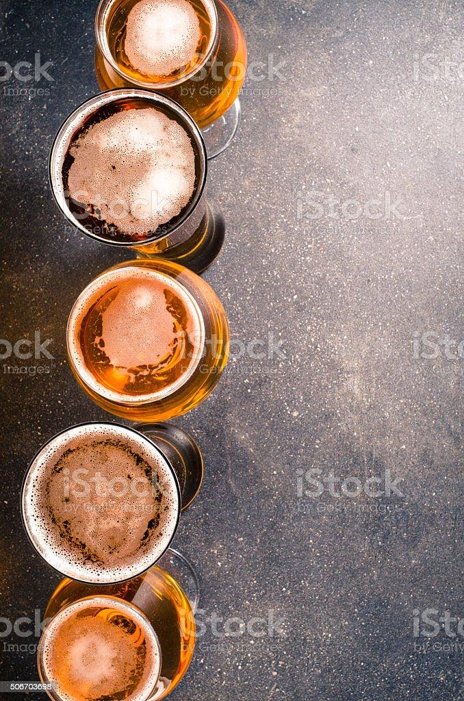 Beer glasses on dark table stock photo