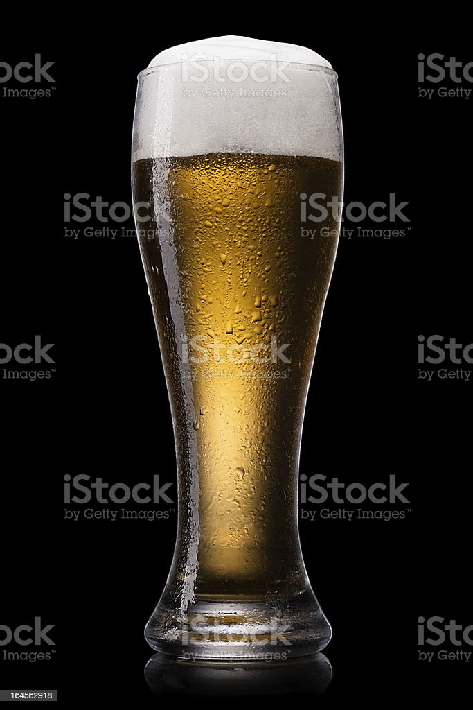 beer in glass on a black royalty-free stock photo