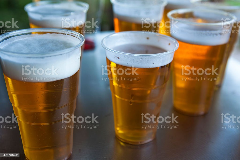 Beer in plastic cups stock photo