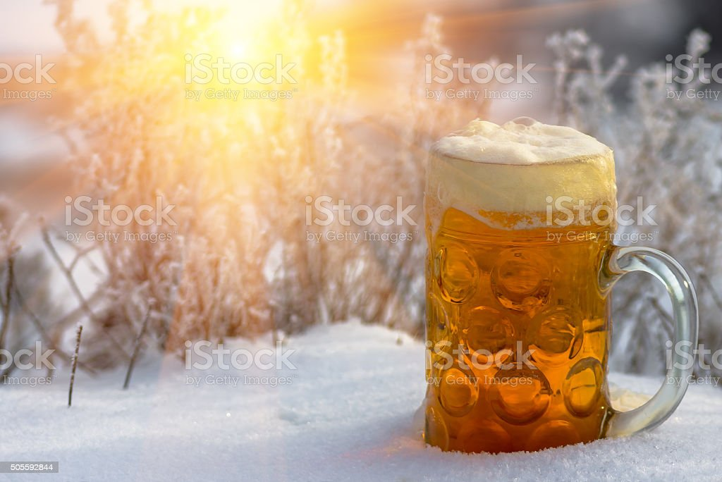 beer in the snow stock photo