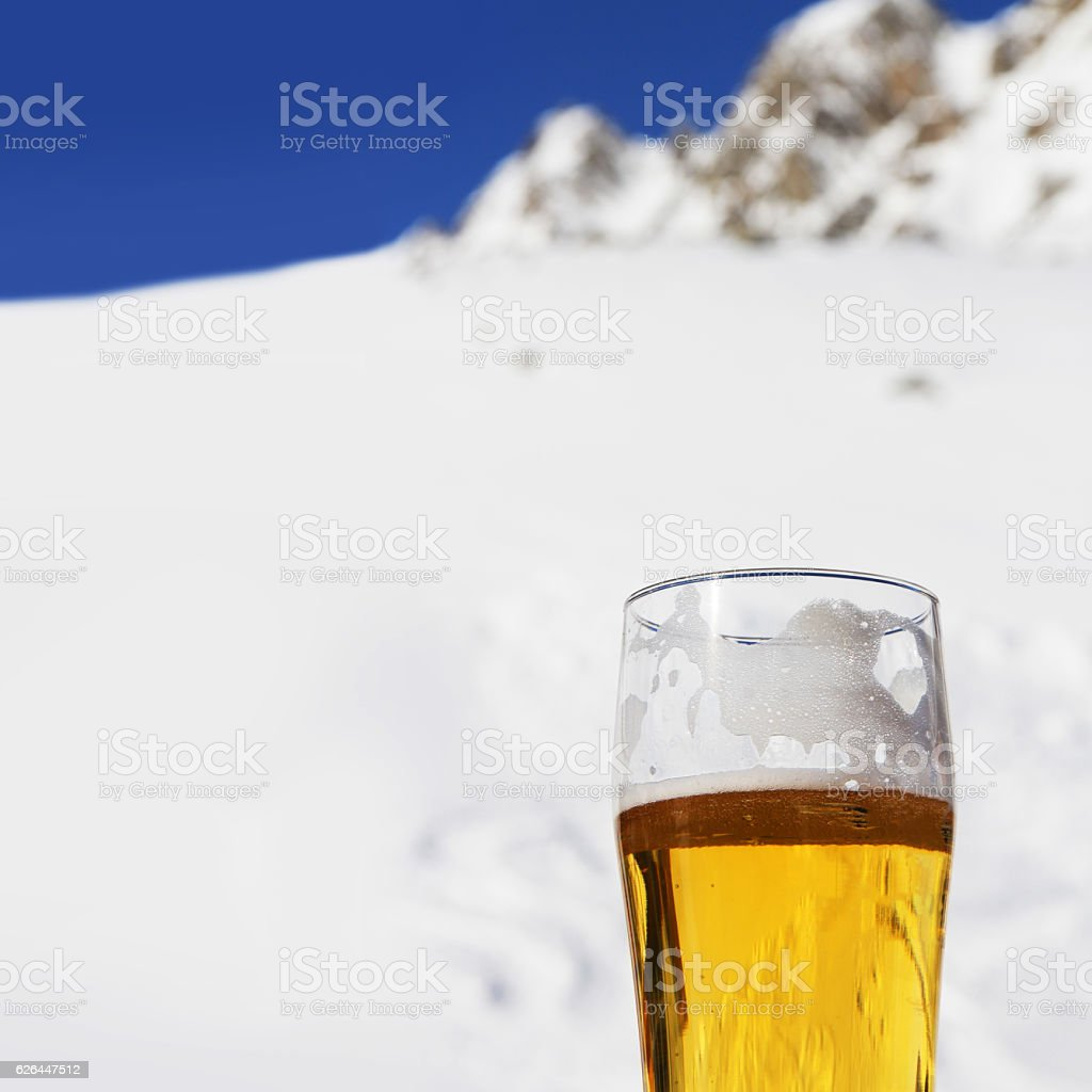 Beer in winter mountains stock photo