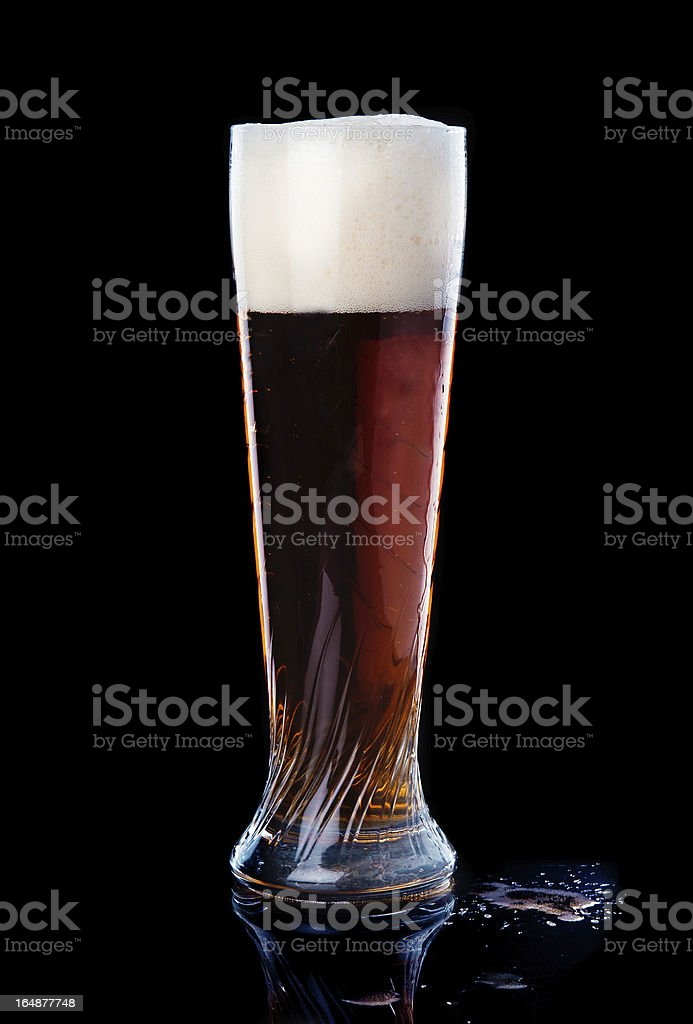 Beer into glass royalty-free stock photo