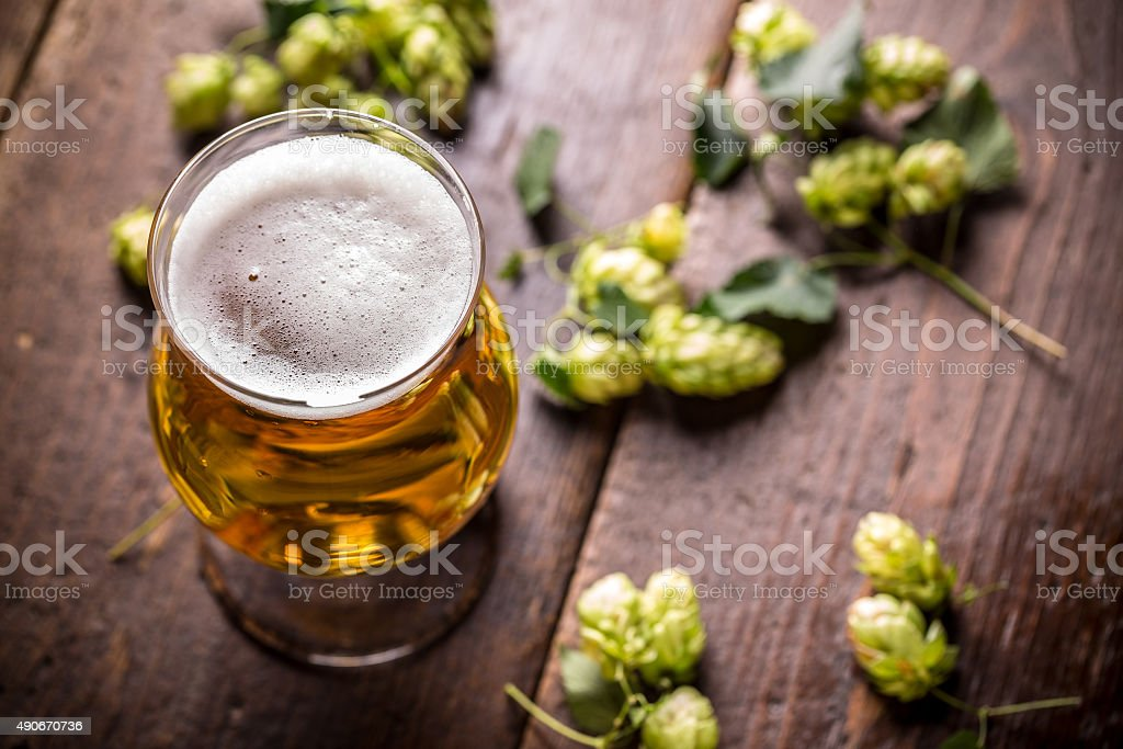 Beer into glass stock photo