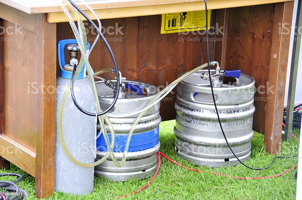 beer kegs under table - Gasflasche unter der Theke stock photo
