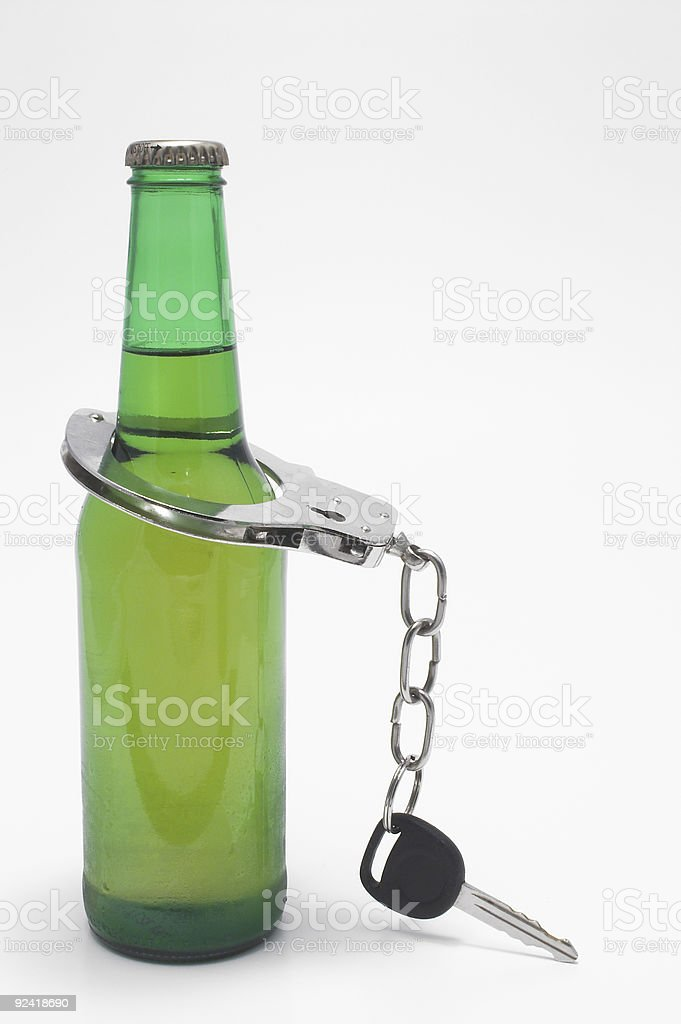 Beer, Keys and Handcuffs - Drunk Driving Concept stock photo