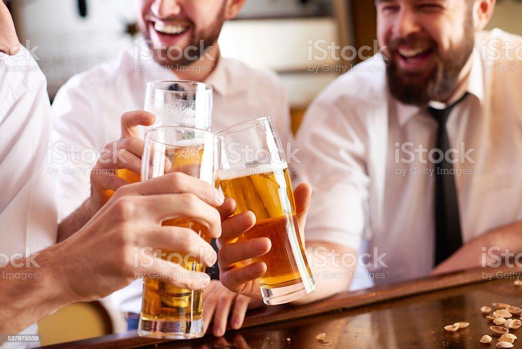Beer makes us happy stock photo