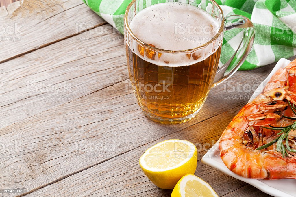 Beer mug and grilled shrimps stock photo