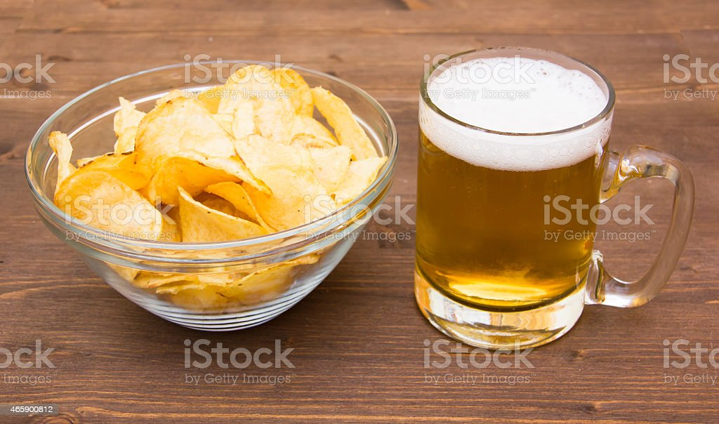 Beer mug with chips of wood stock photo