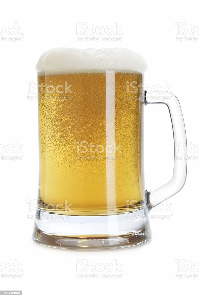 Beer mug with froth stock photo
