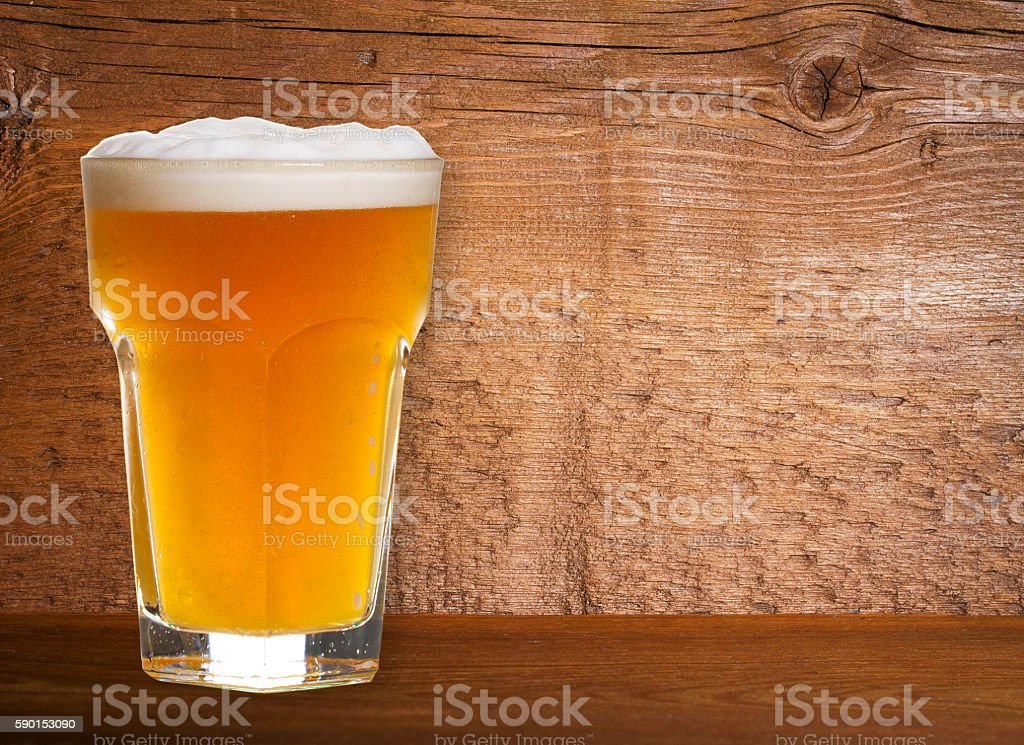 Beer on Old Wooden Shabby Background Close Up stock photo