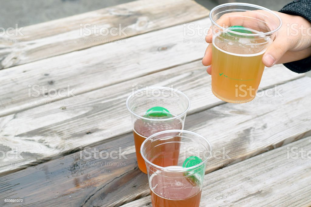 Beer on picnic table stock photo