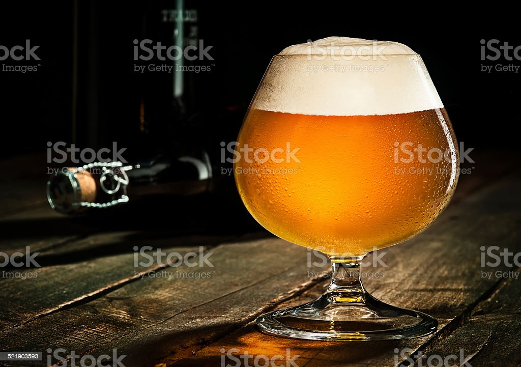 Beer on Rustic Wood Surface stock photo
