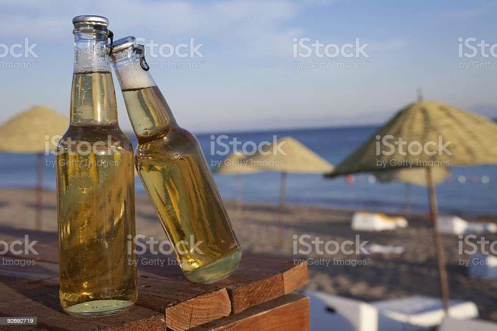 beer on the beach stock photo