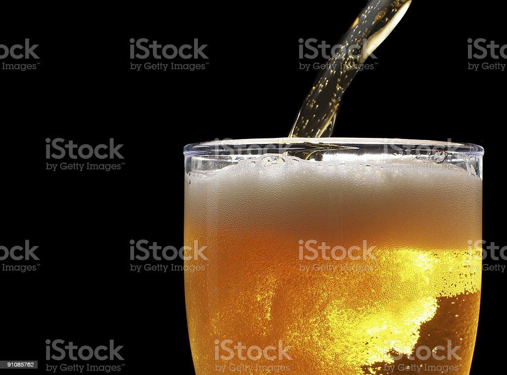 Beer over black stock photo