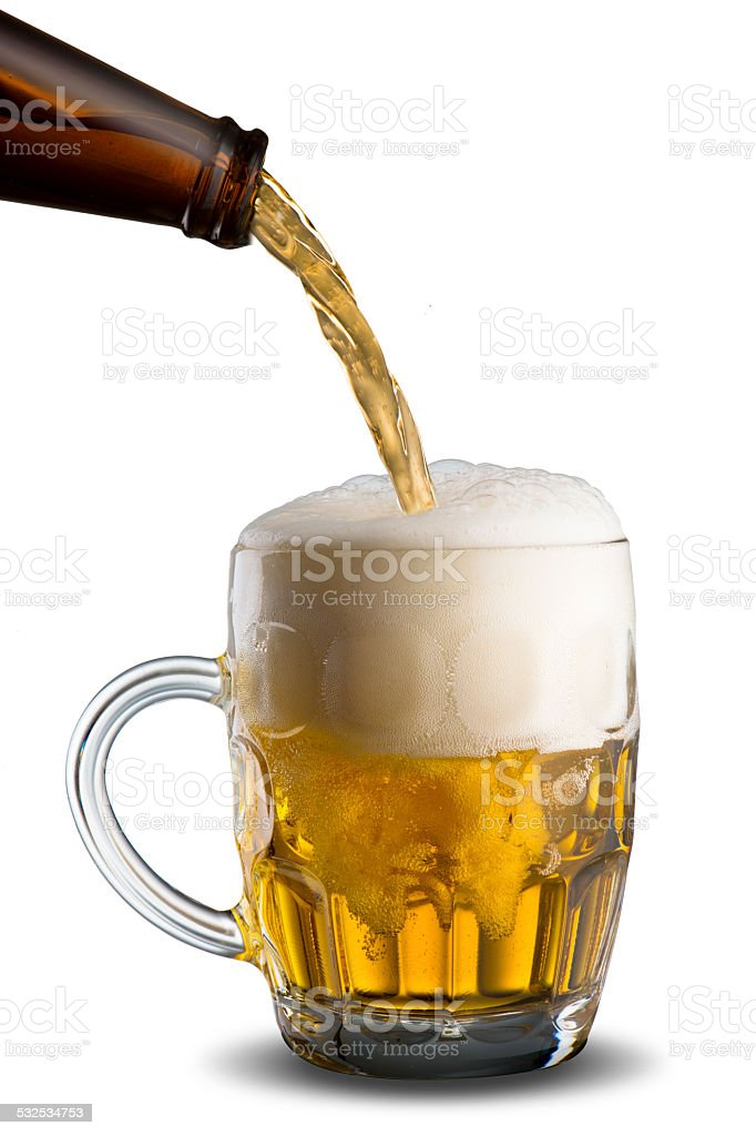 Beer Pour from Bottle to Glass stock photo
