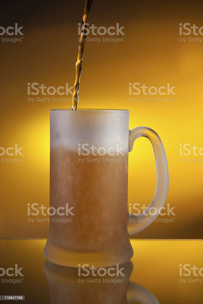 beer pouring into a glass stock photo