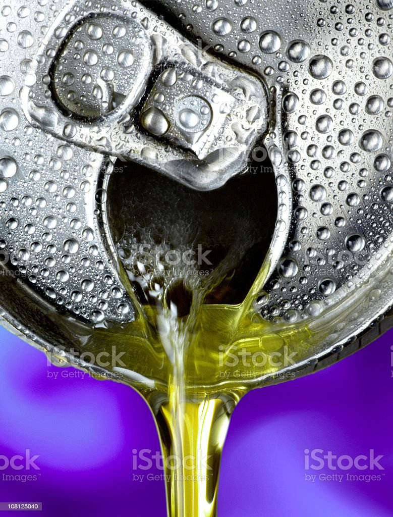 Beer Pouring Out of Can, Close-up royalty-free stock photo