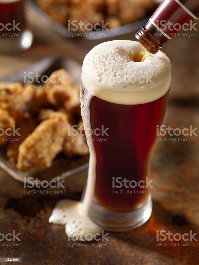 Beer Pouring with Wings stock photo