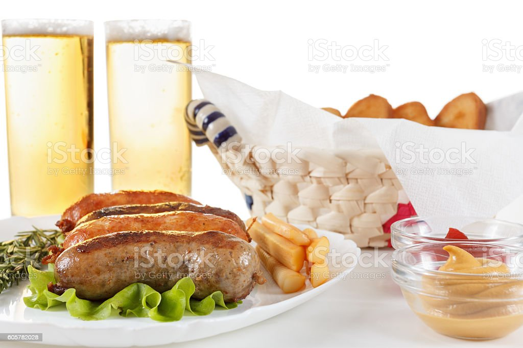 Beer, roast beef or chicken sausage on a plate stock photo