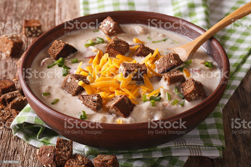 beer soup with bacon, cheddar cheese and croutons closeup stock photo