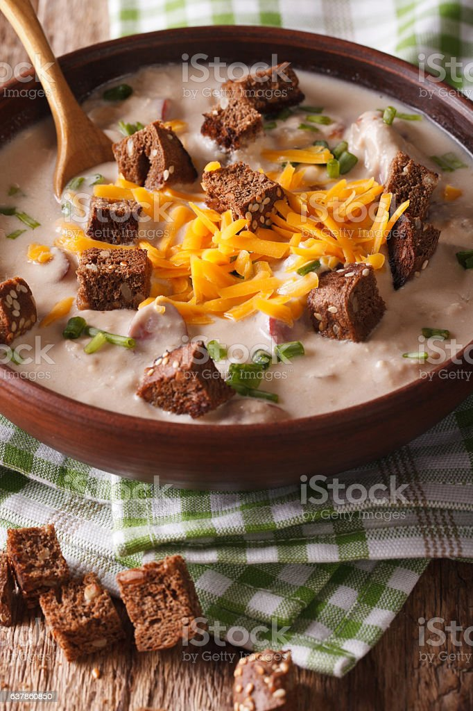 beer soup with bacon, cheddar cheese and croutons closeup. Vertical stock photo