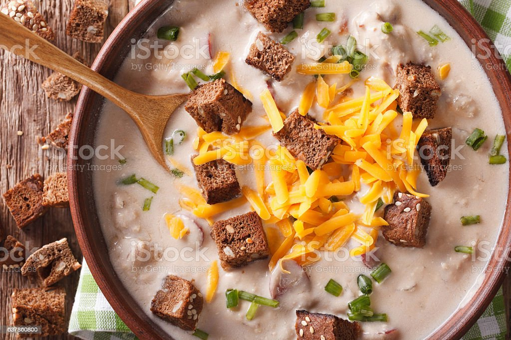 beer soup with bacon, cheddar cheese and croutons macro. Horizontal stock photo