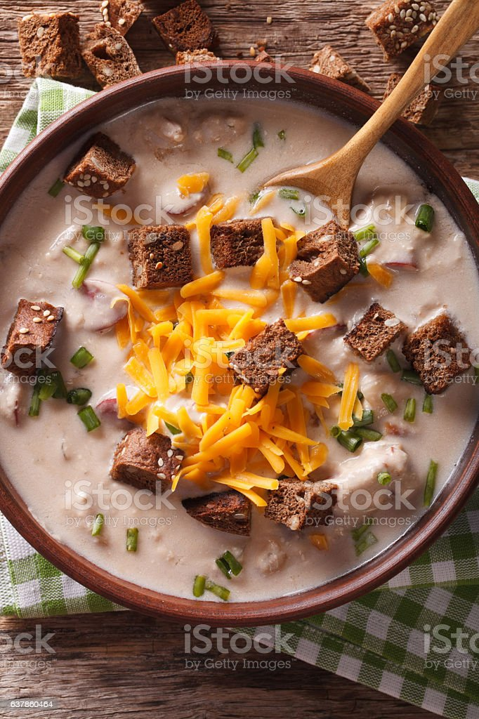 beer soup with bacon, cheddar cheese and croutons macro. vertical stock photo