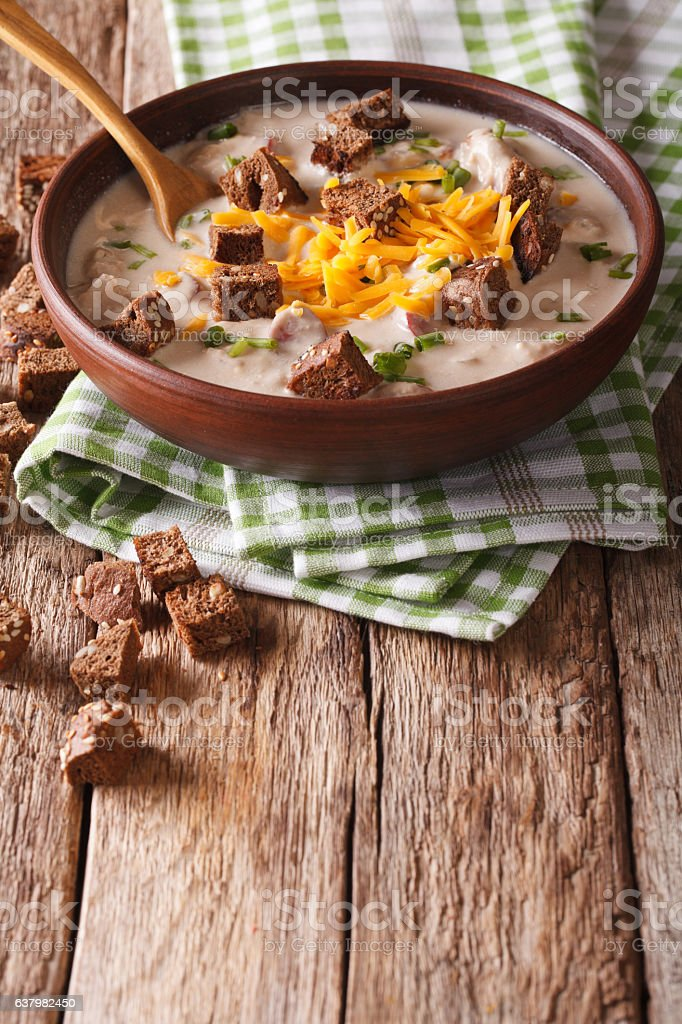beer soup with sausage, cheddar cheese and croutons in bowl stock photo