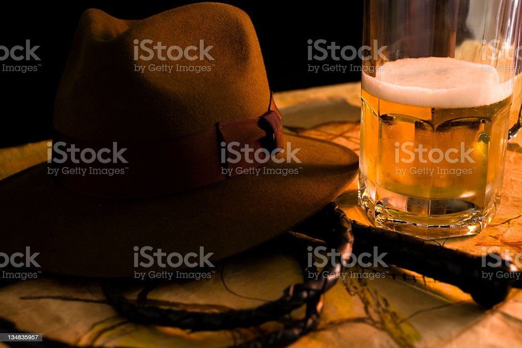Beer stein  brown felt hat, whip and map on table stock photo