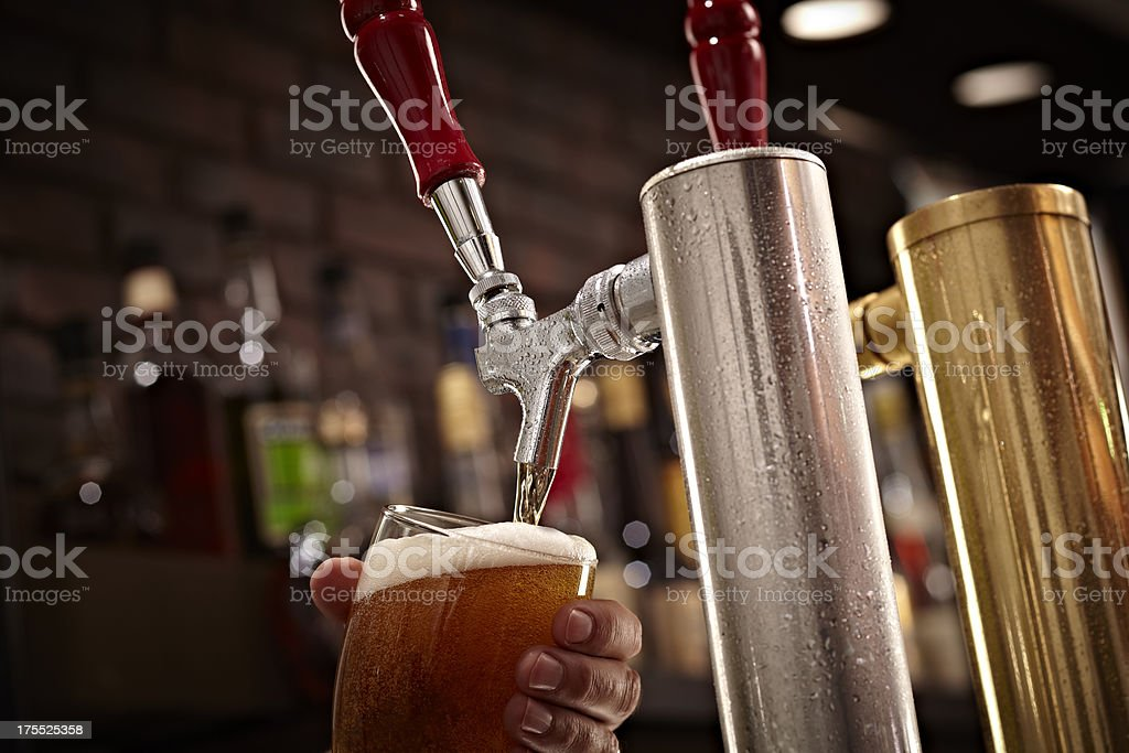 Beer Tap and Pint stock photo