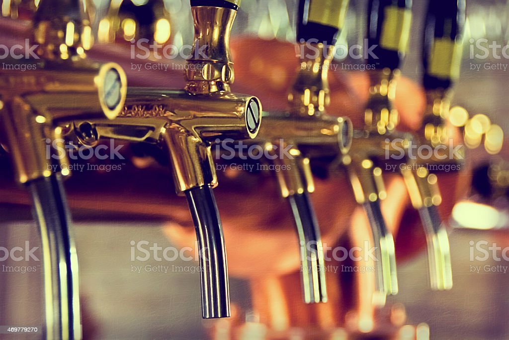 Beer taps at a bar with golden bars stock photo