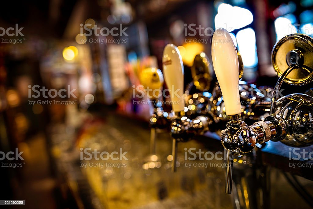 Beer Taps in a Bar stock photo