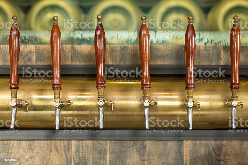 Beer taps inside a pub stock photo