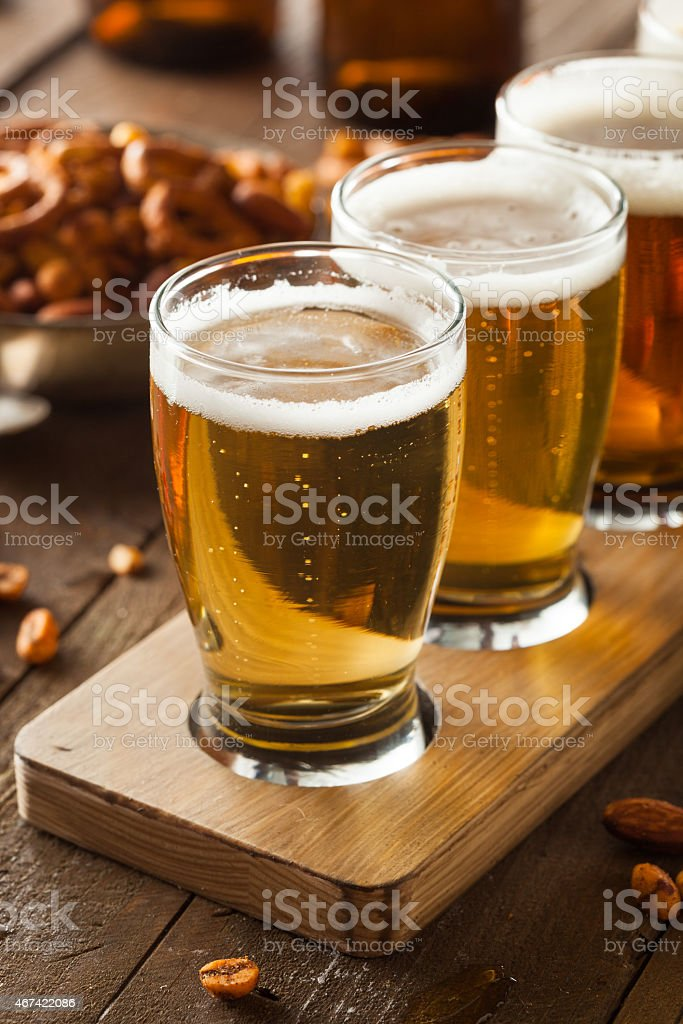 Beer tour on a bar with pretzels stock photo
