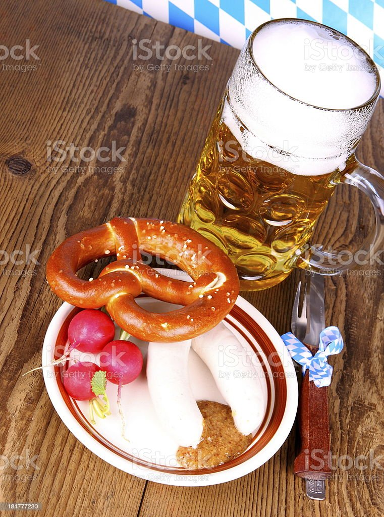 Beer, white sausage, pretzel and radish - Oktoberfest menu stock photo