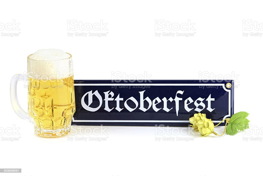 Beer with bavarian Oktoberfest info sign and hop stock photo