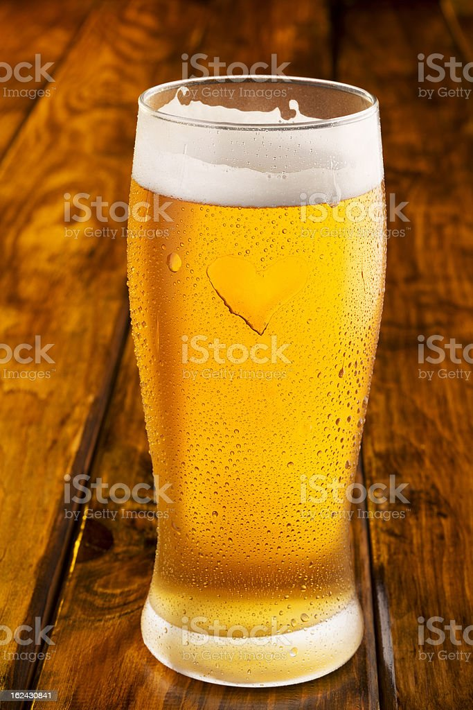 Beer with heart shape condensation royalty-free stock photo