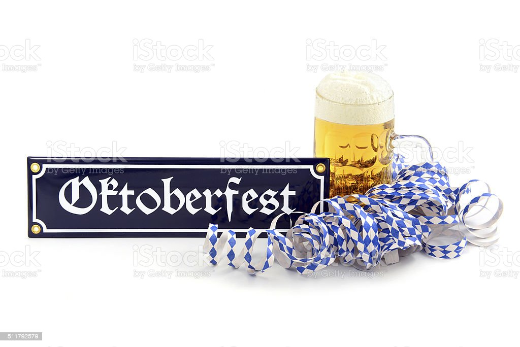 Beer with Oktoberfest info sign and bavarian party streamer stock photo