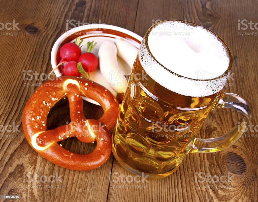 Beer with pretzel, white sausage and radish stock photo