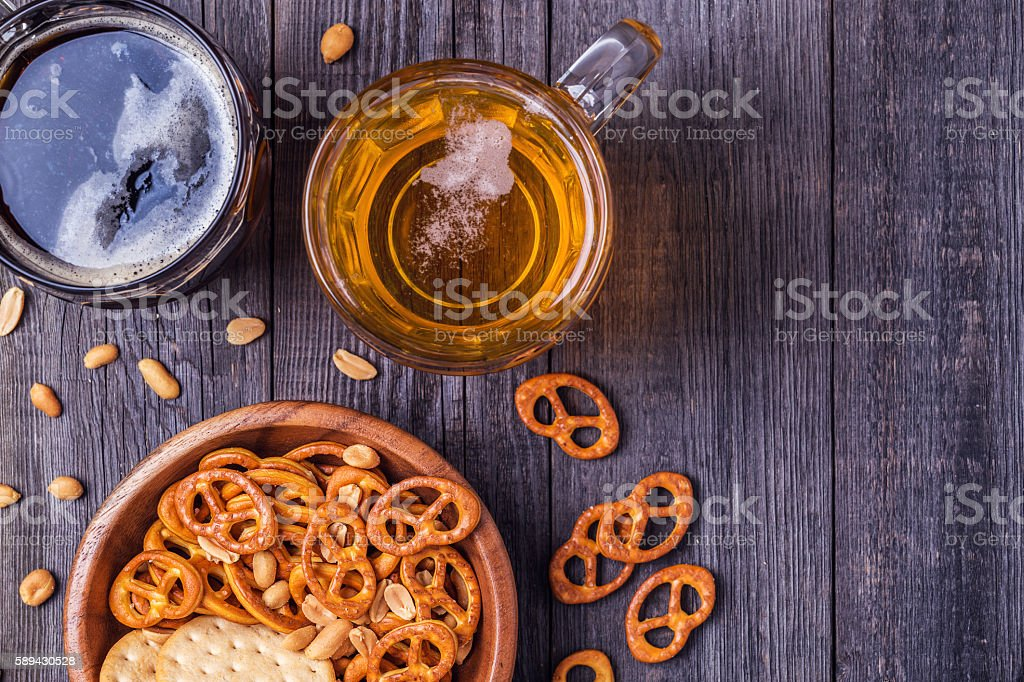 Beer with Pretzels, Crackers and Nuts. stock photo