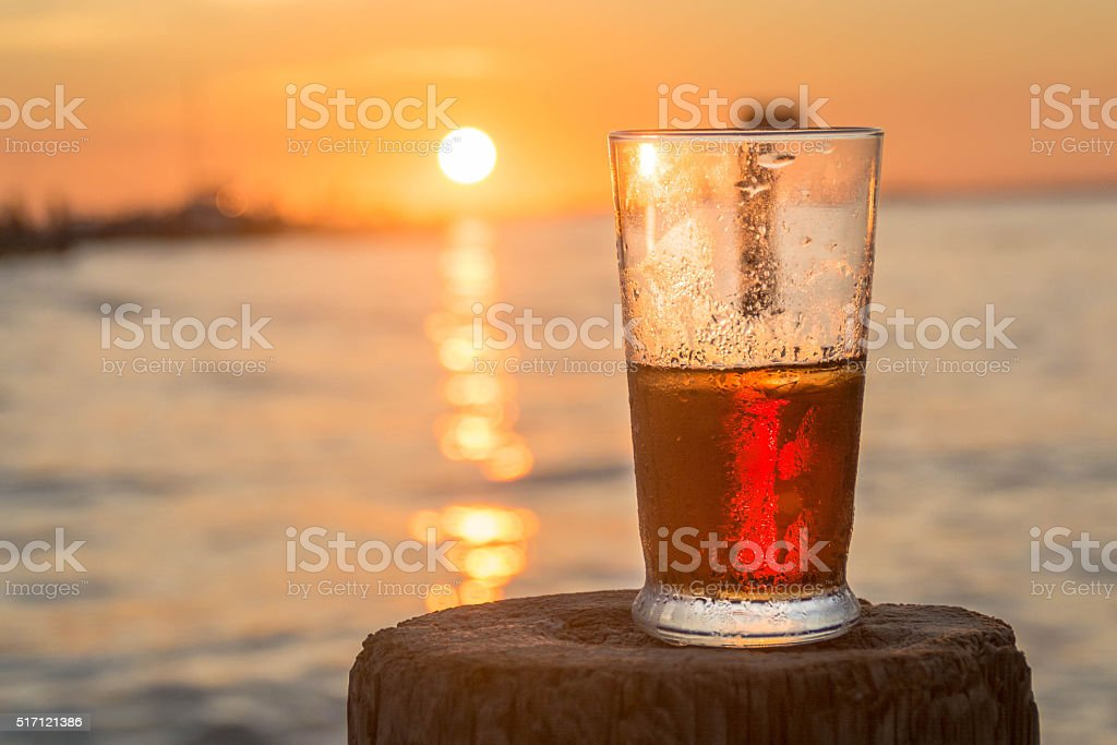 Beer with sunset in background stock photo