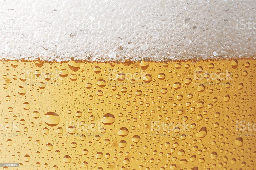 Beer with transpiration detail with drops royalty-free stock photo