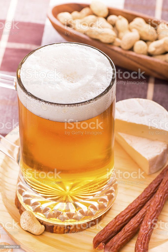 Beer with various snacks royalty-free stock photo