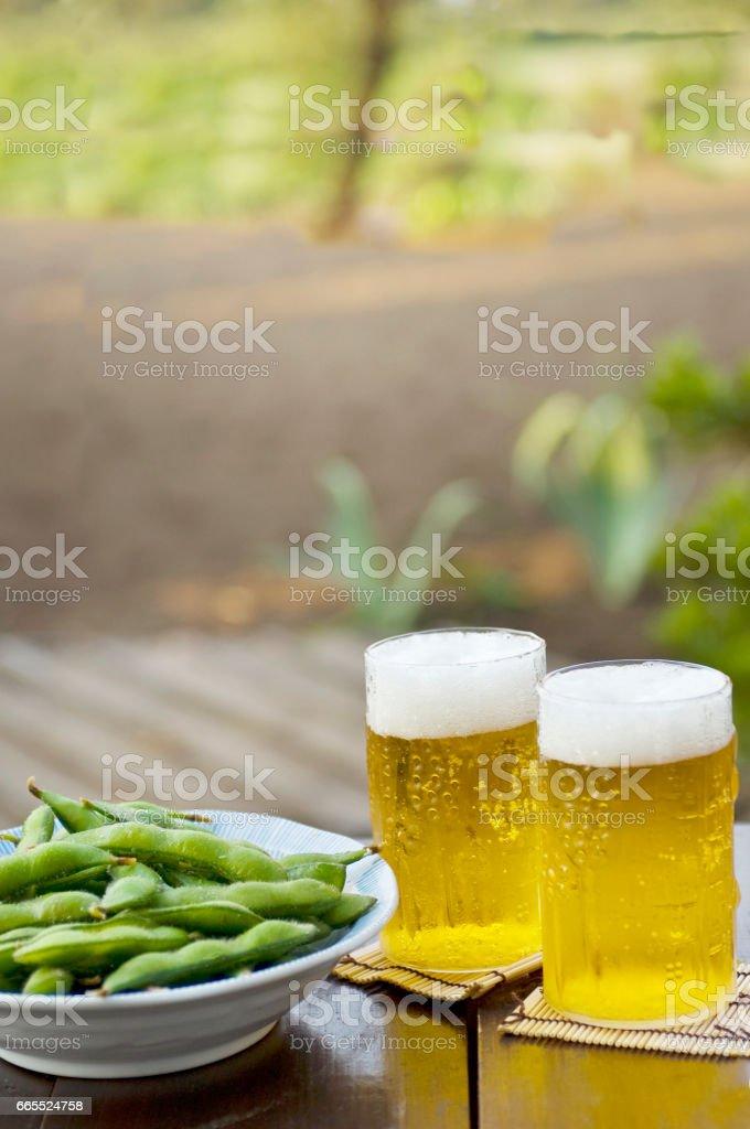 Beers and Edamame stock photo