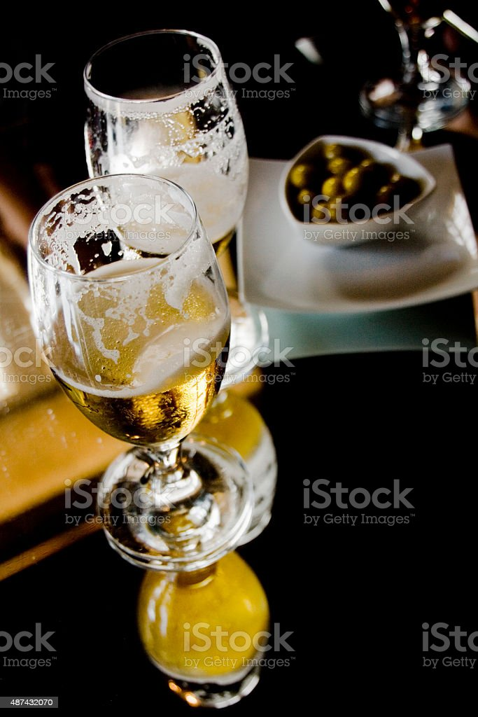 Beers and olives stock photo