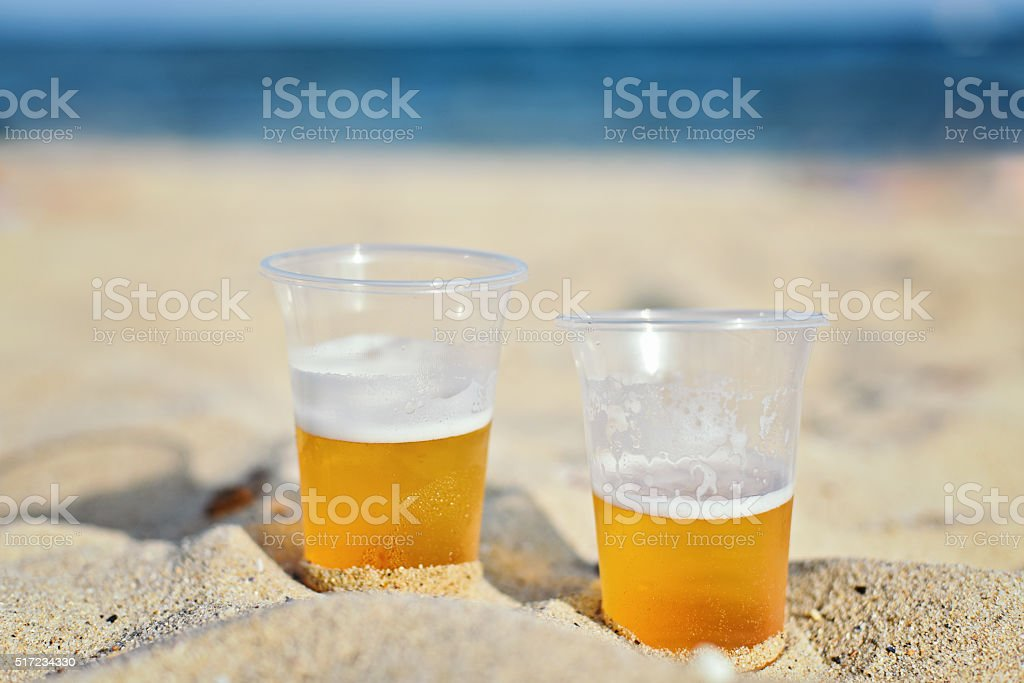 Beers on the sand stock photo