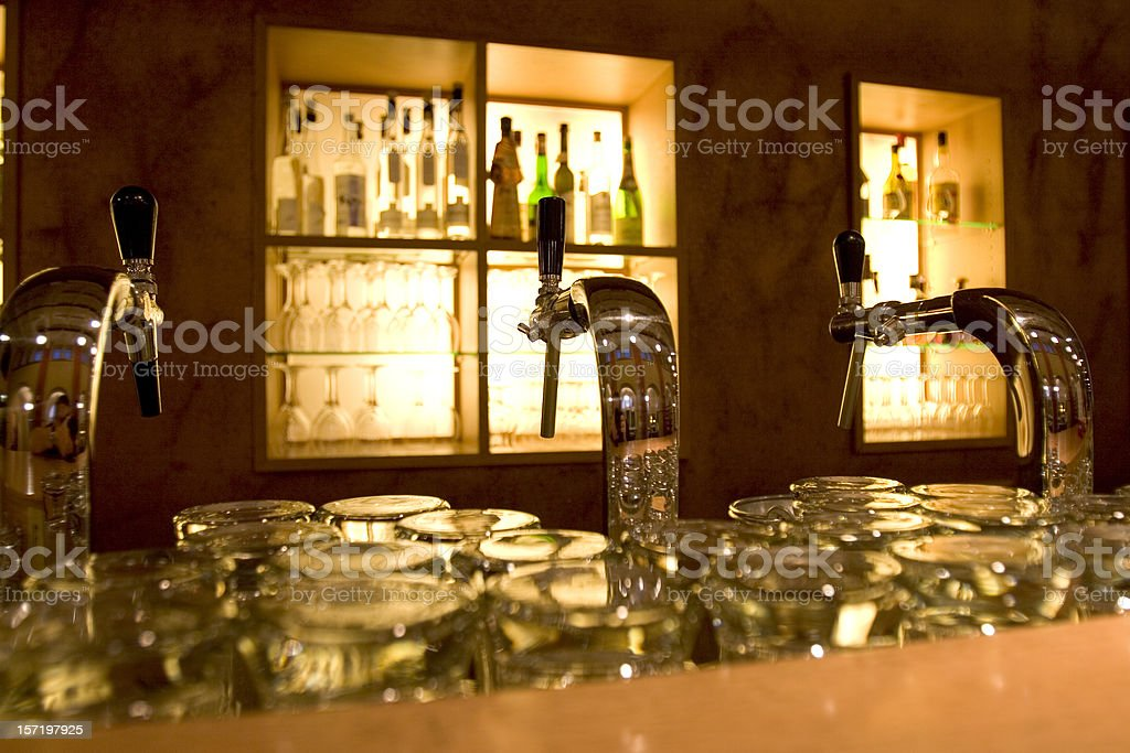 Beer-taps in a bar royalty-free stock photo