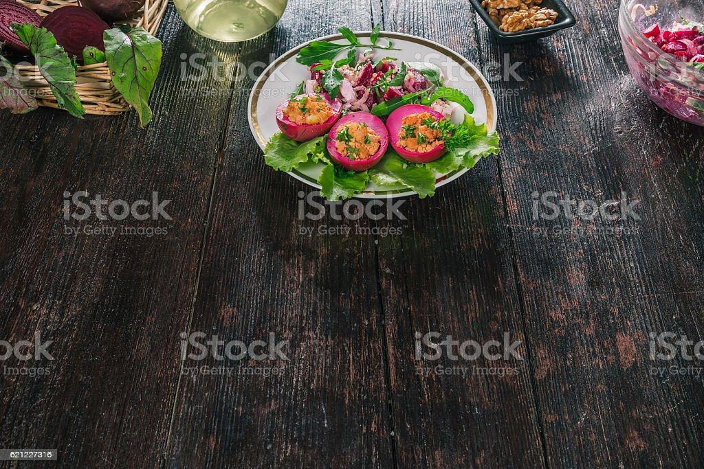 Beet eggs with salad stock photo
